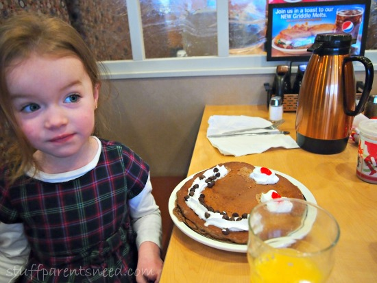 child with a pancake breakfast at IHop