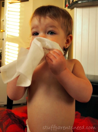 baby sucking on wipes
