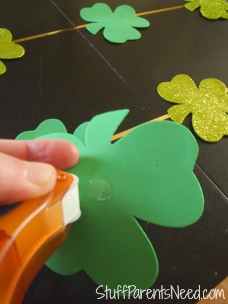 applying glue dots to shamrock