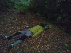 About 47 hours in - taking a 10 minute 'magic nap' on the trail. Still quite cold so we layer up before laying down.