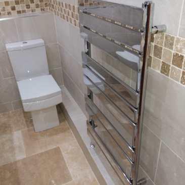Chromed Towel Rail Radiator and Square Toilet