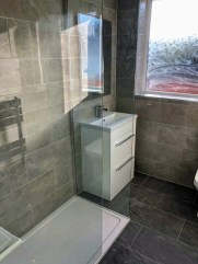 The bathroom also included the forever popular vanity unit and mirror combo.