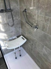 For the walk in shower itself we have fitted a large walk in tray & waterfall shower along with the inclusion of the fold away seat and grab rail, to enable our customer ease of use of their Stunning Bathroom.