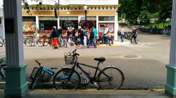 Random tourists and more bikes outside of Doud's Market.
