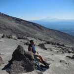Resting, with a view of Mount Adams (?) around the transition between boulders and scree.