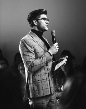 A man speaking to a mic