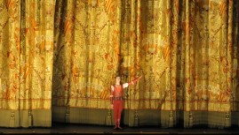 Alexander Zaitsev takes a bow in front of the Bolshois spectacular curtain