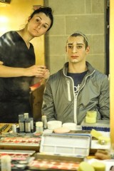 Lola Khourramova applies Arman Zazyan's make up before the performance of The Taming of the Shrew