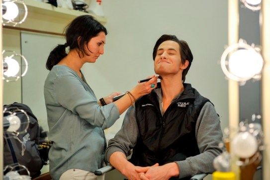 Alexander Jones is dancing Petrucchio on the first night. Lola Khurramova is applying his make up and – of course – the fake beard.