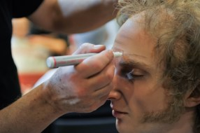 "Cedric Rupp having his make up done for ""old people"" in the second act."