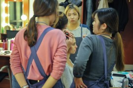 Joana Romaneiro being prepared for the performance by our makeup staff, attentively watched by the Korean assistants.