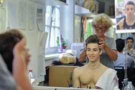 Enes Comak getting his hair prepared