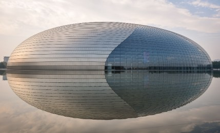 The impressive National Center for the Performing Arts reflecting in the artifical lake