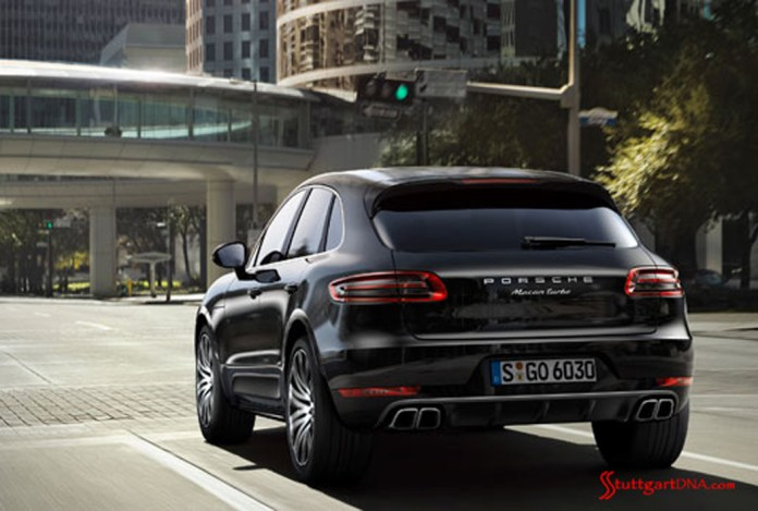 2013 LA Auto Show Porsche Macan world debut: The 2015 Porsche Macan Turbo in black, seen from the left-rear view, at a downtown-L.A. stoplight. Source: PCNA