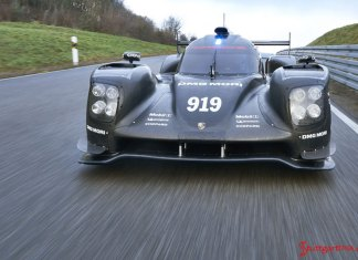 2015 Porsche 919 Hybrid debut: 919 at speed on track straightaway, head on, at start of testing for the 2015 season. Source: PCNA