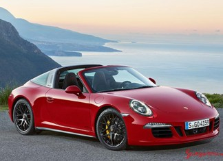 911 Targa 4 GTS and Cayenne Turbo S 2015 world premiere: The 2015 Detroit-Show reveal of a 911 red Targa 4 GTS, seen from its right-side view against a breathtaking coastal vista. Credit: PCNA