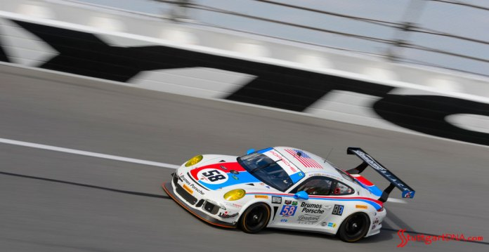 2015 53rd Rolex Daytona 24 has 12 Porsche 911 racecars: Seen here are the No. 58 Brumos colors of the Wright-Dempsey team's 911 on the Daytona banking, 2015. Source: PMNA