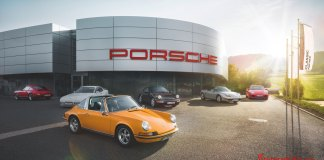 A Porsche Center dealership is depicted here, representing a one of the 100 Classic Partners worldwide, which provide parts, repair and maintenance to modern classic and vintage Porsches round the globe. Credit: Porsche AG