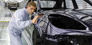 Porsche delivers 189,850 cars worldwide in 2014A Works photo on the Macan production line showing a Leipzig worker executing meticulous quality control on a Macan body shell's fresh paint finish. Credit: Porsche AG