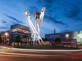 Porsche SE 2014 group profit 2 billion euro: A wide-angle nighttime shot of Porscheplatz, the Porsche Factory and the towering draft of a centerpiece sculpture, Stuttgart. Credit: Porsche AG