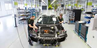 The Porsche 918 Spyder production ends: Seen here coming down the Stuttgart-Zuffenhausen assembly line is the very last Porsche 918 Spyder, naked and head-on, without its body paneling and body parts. Credit: Porsche AG