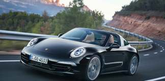 Porsche wins JD Power Initial Quality Study: seen here is the left-front angle of a black 911 Targa 4, top off, carving the curves of a mountain road. Credit: Porsche AG