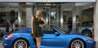 Maria Sharapova is pictured dropping in at the Porsche Centre Mayfair and posing with the UK's only new Boxster Spyder, on her way to the WTA Pre-Wimbledon Party at London's Kensington Roof Gardens. Credit: Porsche AG