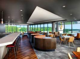 Porsche opens Restaurant 356 at Experience Center in Atlanta. This shot is taken inside the new restaurant overlooking the Porsche signage and track in b.g. out the floor-to-ceiling windows. Credit: PCNA