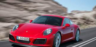The new 2017 Porsche 911 turbo Carrera 991.2: A new red 2017 911 Carrera is seen from its front-left view, cruising along a rocky road. Credit: PCNA