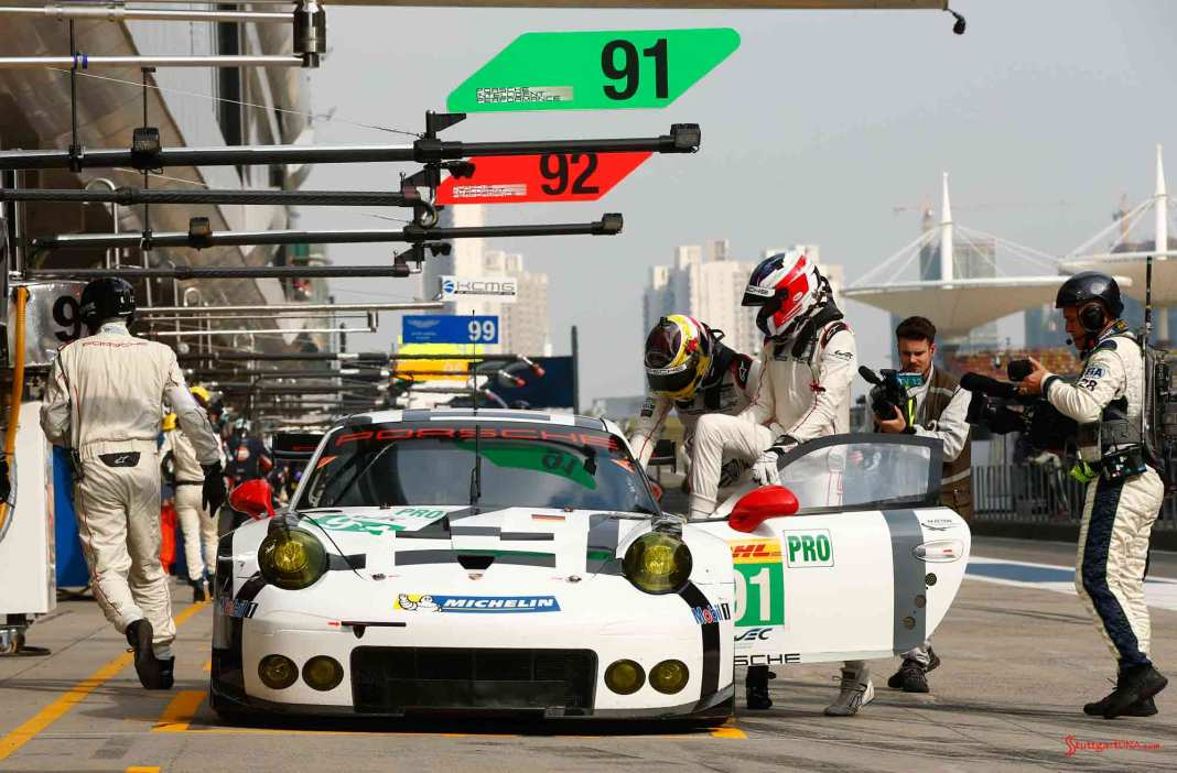 Manthey Porsche RSRs contest 2015 Bahrain WEC titles: No 91 in Shanghi pits before 2015 Bahrain. Credit: Porsche AG