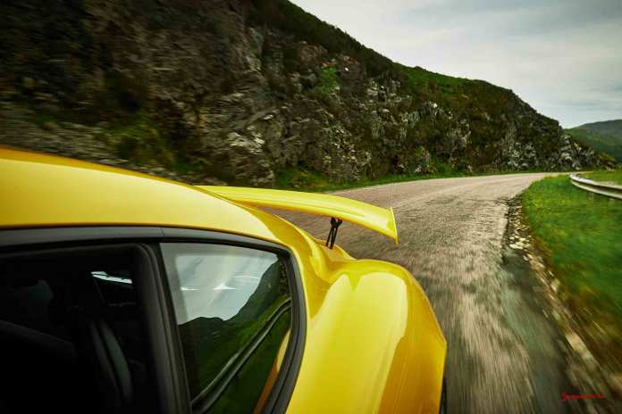Porsche Certified Pre-Owned (CPO) Program: Cayman GT4 and wing on Scotland road. Credit: Porsche AG