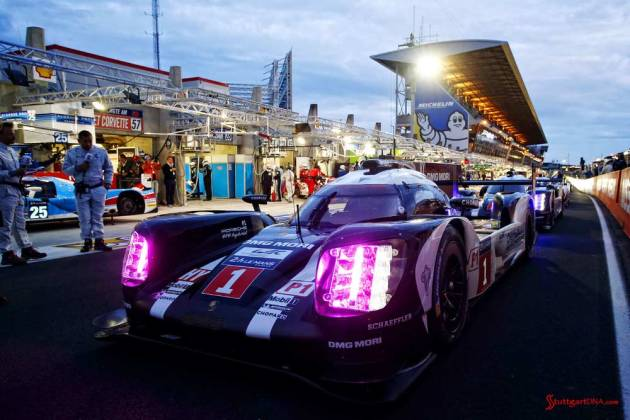 Porsche garners 18th overall win at 84th Le Mans 2016: 919 No. 1 at pit out at dawn. Credit: Porsche AG