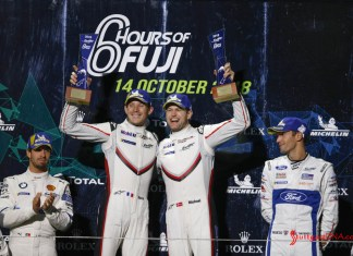 Porsche wins 2018 WEC Fuji 6 Hours: Seen here are the ecstatic, victorious Kevin Estre and Michael Christensen (l-r) at the top of the 2018 WEC Fuji 6 Hrs GTE-Pro podium. Credit: Porsche AG
