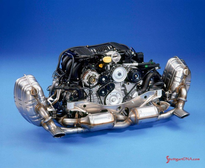 996-gen Porsche 911 Buyer Guide: In contrast to the adjacent 986 engine, pictured here is 996 Carrera 3.4-liter flat six from 1998, with its exhaust system attached. Credit: Porsche AG