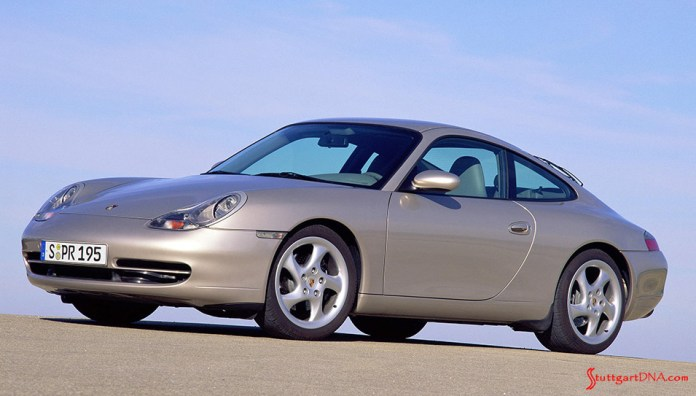 996-gen Porsche 911 Buyer Guide: Seen in a brochure-type photo here is the introduction of a 996 Carrera tan coupe, viewed from the 996's left front. Credit: Porsche AG