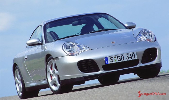996-gen Porsche 911 Buyer Guide: We have the pleasure here of looking at a 996 silver Carrera 4S, from a low right-front angle, at rest. Here it displays its Turbo look; this replaced the Carrera 4 coupe's front-fascia look in model-year 2002. Credit: Porsche AG