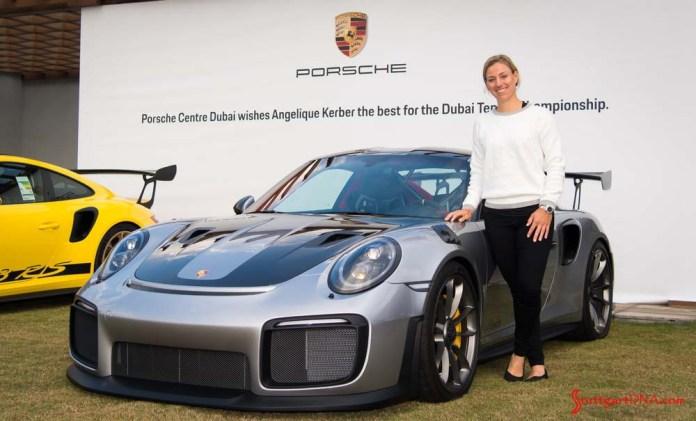 Wimbledon champion Kerber tours Porsche Centre Dubai: Seen here is Kerber posing with a silver 911 GT2 RS in Dubai. Credit: Porsche AG