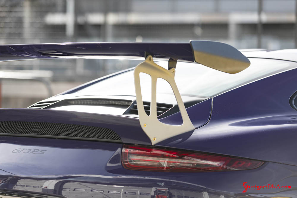 December 2018 Porsche USA Sales: The awesome aero wing of a purple 911 GT3 RS (9911st-Gen) is pictured here. Credit: Porsche AG