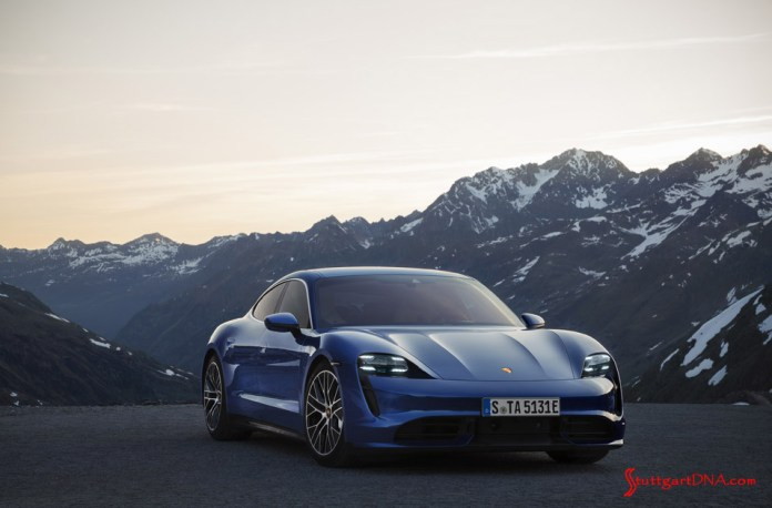 Porsche Taycan first electric sports car world premiere: Pictured is a blue Taycan, right-front, poised with a mountain range in b.g. Credit: Porsche AG