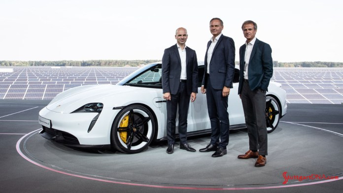 Porsche Taycan first electric sports car world premiere: Seen here is a white Taycan with Porsche executives at the Germany premiere. From left to right: Manfred Harrer Vice President Chassis Development; Oliver Blume, Chairman of the Executive Board of Porsche AG; and Michael Mauer, Vice President Style Porsche . Credit: Porsche AG