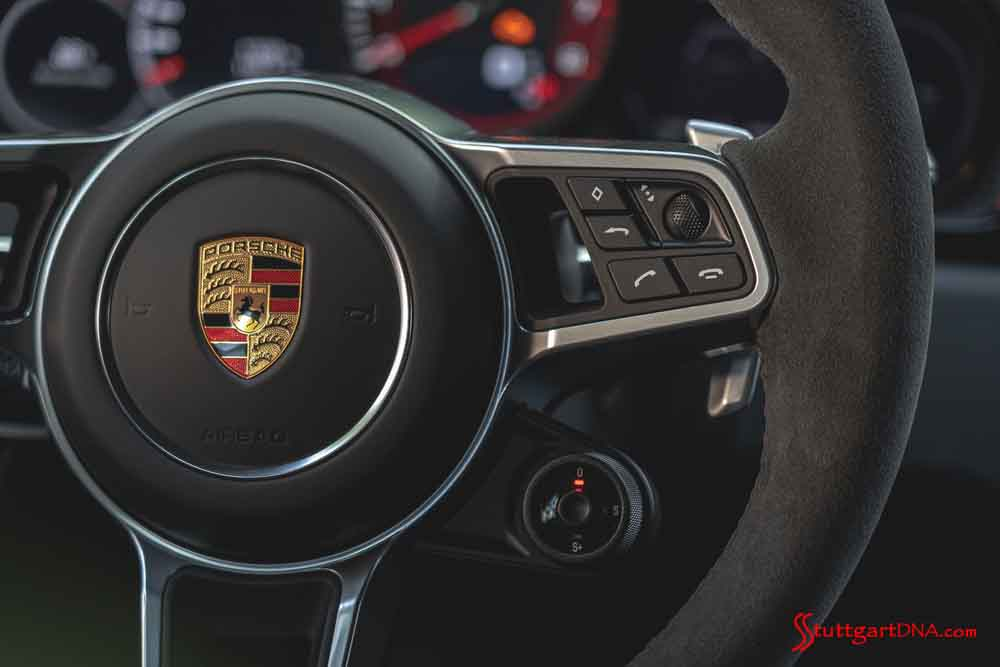 Porsche second-quarter 2020 USA retail sales: Seen here is the Porsche crest centered on the steering wheel of a Porsche 911. Credit: Porsche AG.