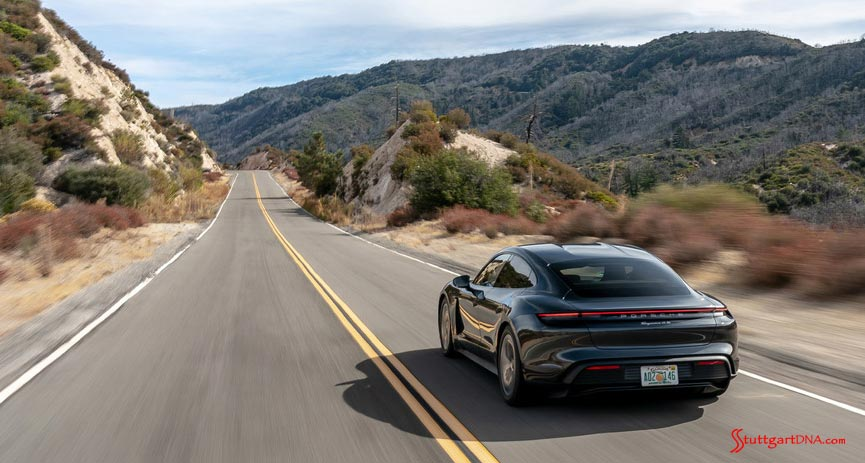 2020 Porsche USA sales: Pictured here is a Taycan 4S, from the left-rear, cruising down a mountain road. Credit: Porsche AG