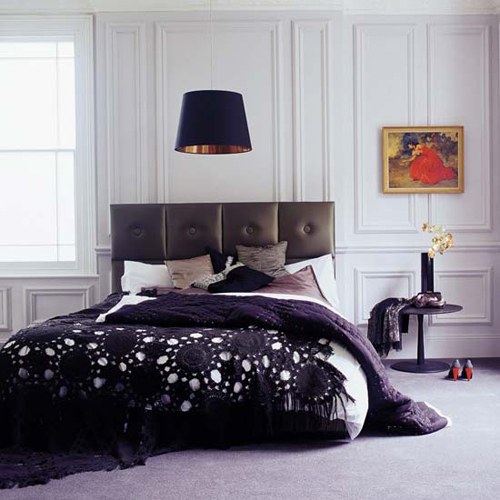 Ultra-luxury-modern-bedroom-with-bed-with-dark-leather-headboard-chandelier-and-bedside-table