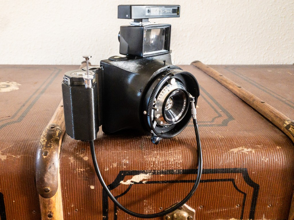 My Ligero camera with a 65mm lens and an early Model K film-back. I added an external viewfinder, Blik rangefinder and shutter release cable grip