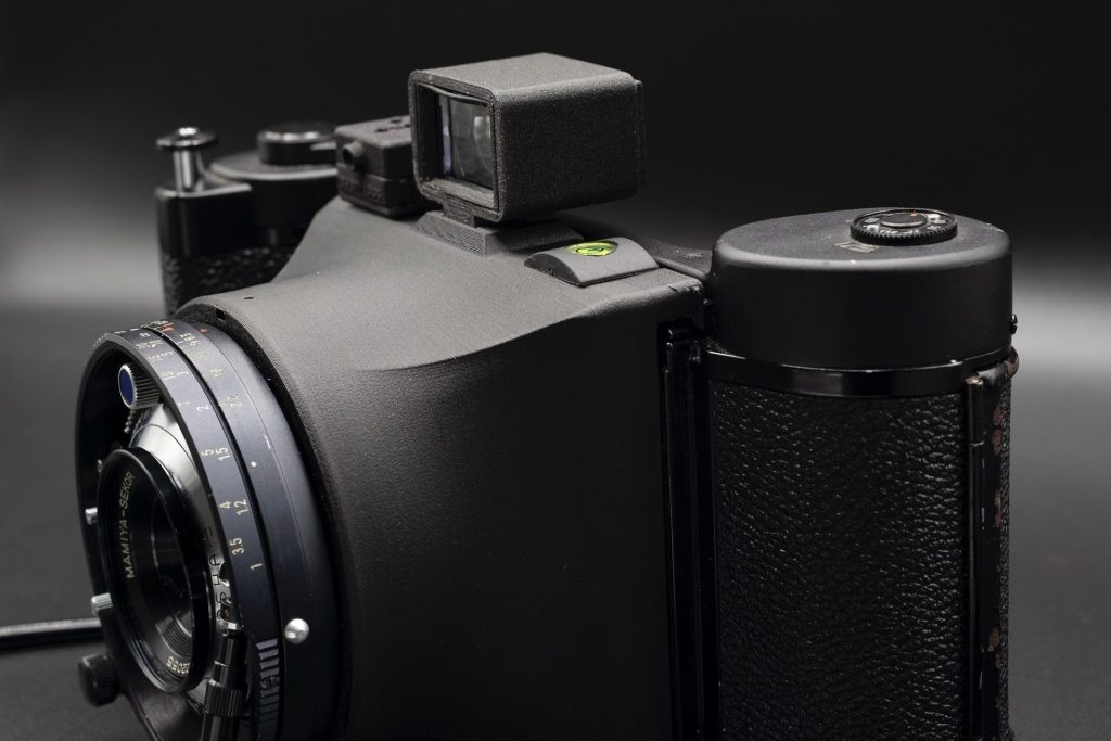 Ligero camera with a Mamiya Press 65mm lens and a Model 3 filmback (Source: MaxWanderlush)