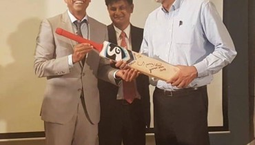 see Younis Khan Donates His Signed Bat To TCF