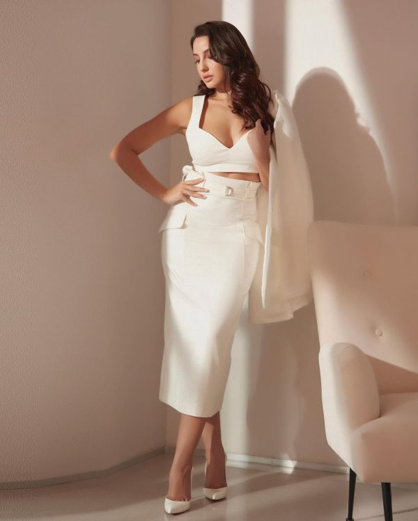 Nora Fatehi Gives Bossy Look In White Stunning White Outfit