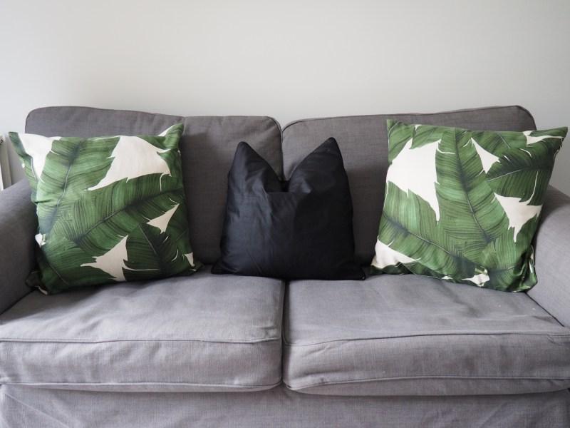 Sofa, Ikea. Leaf Cushions, H&M.