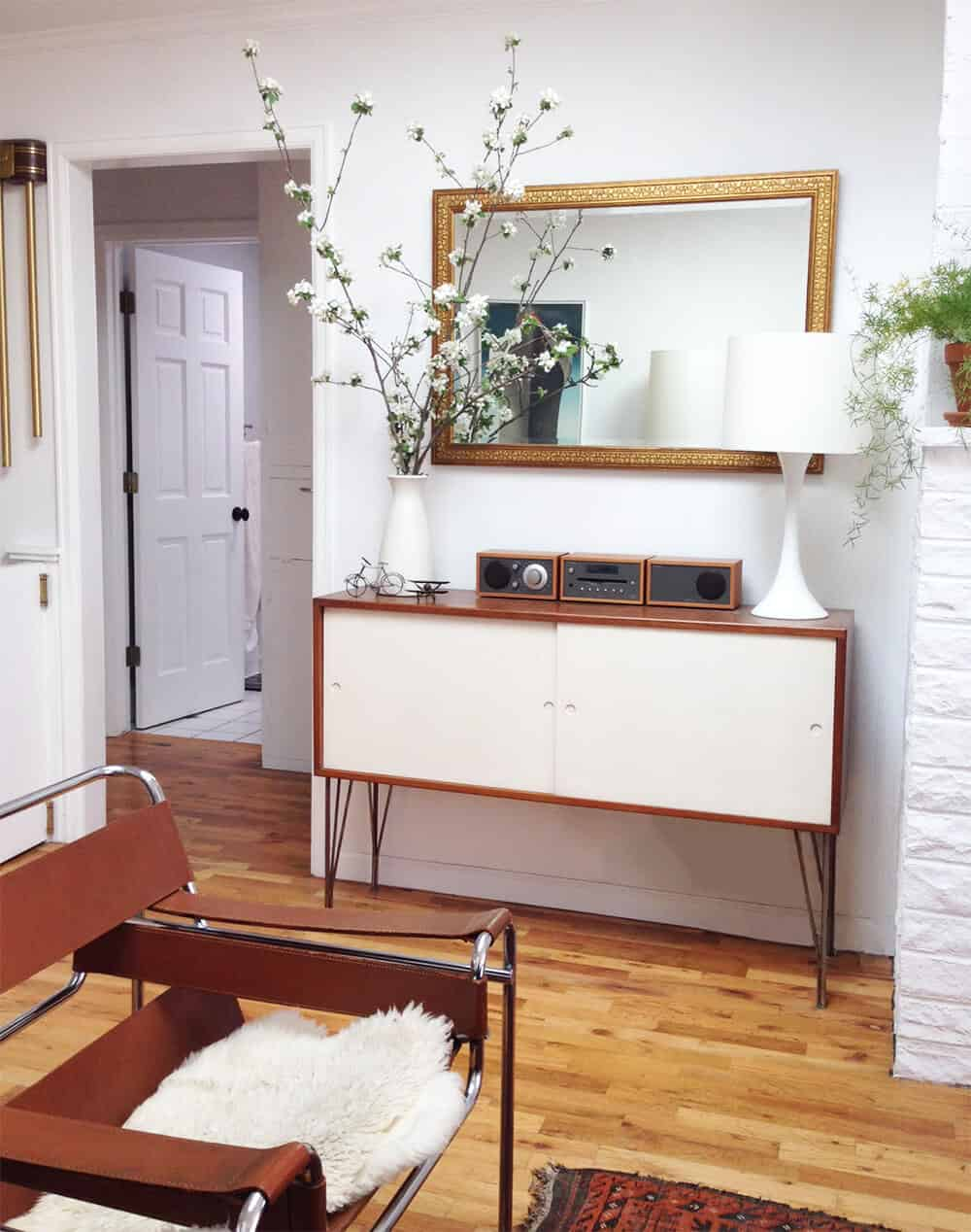 Hilary Sontag Living Room Redesign White and Wood Mid Century