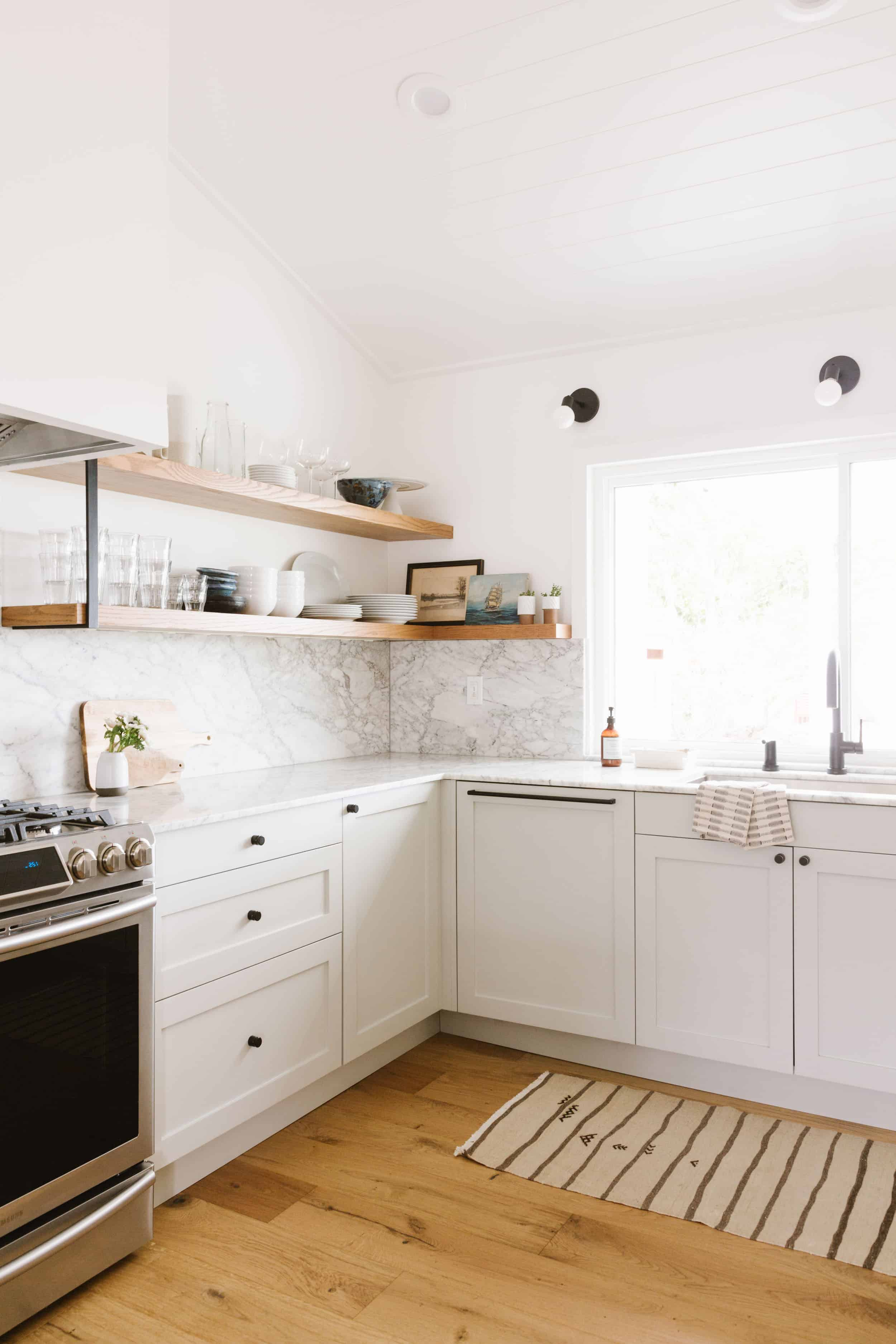 Samantha Gluck Emily Henderson Kitchen Marble Backsplash White Cabinets Scandi